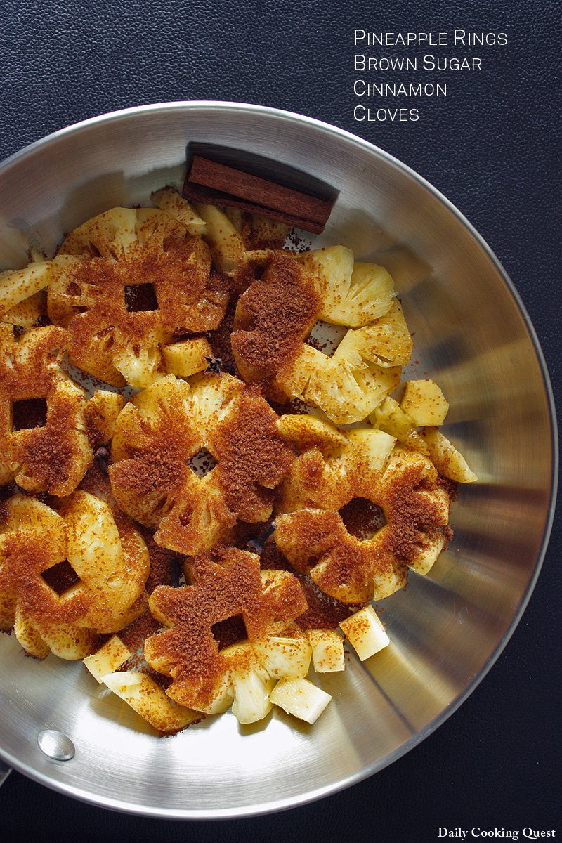 First, saute pinapple rings, brown sugar, cinnamon stick, and cloves in a pan.
